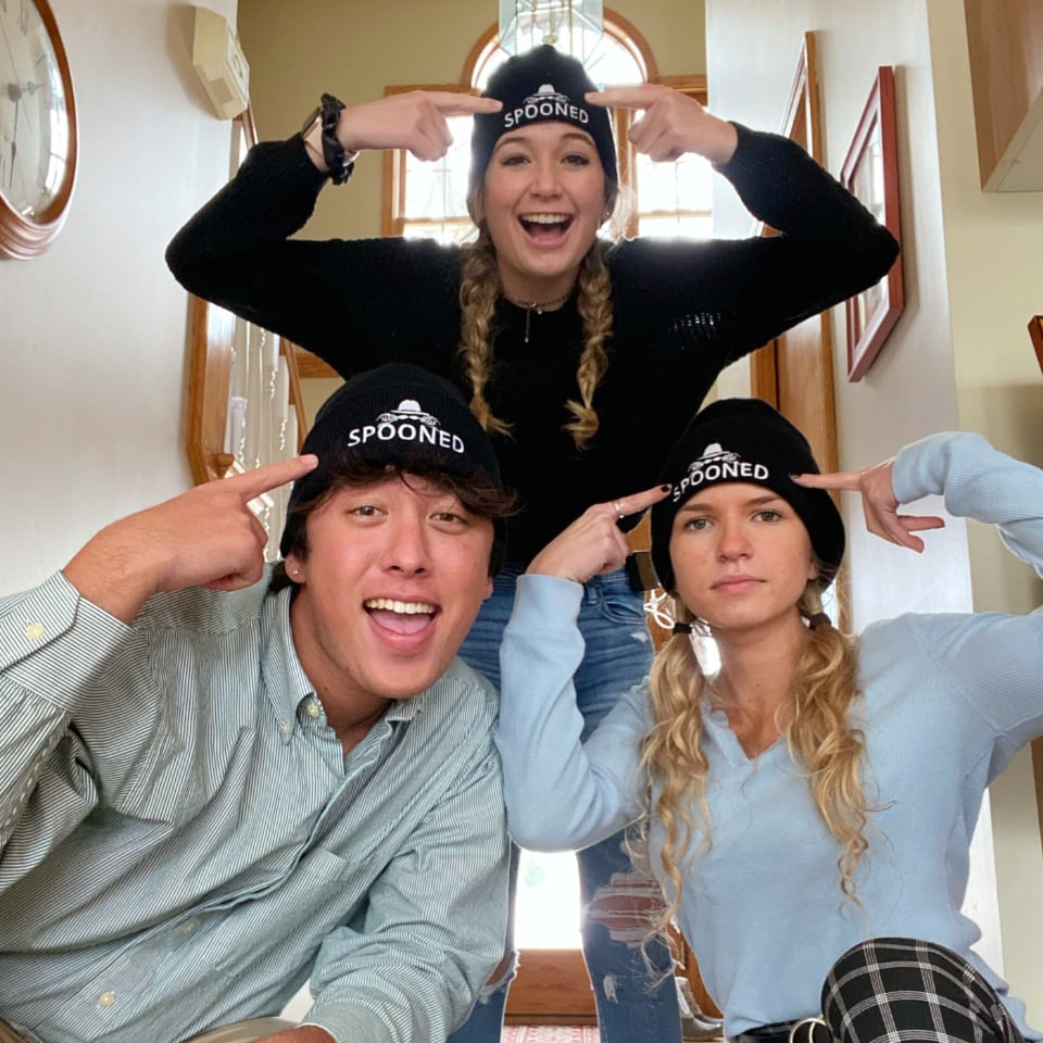 three teenagers wearing get spooned beanies
